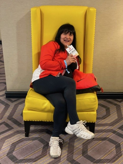 Entrepreneur sitting in a yellow chair
